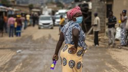 A woman wearing a face mask on the street in Alexandra, South Africa.