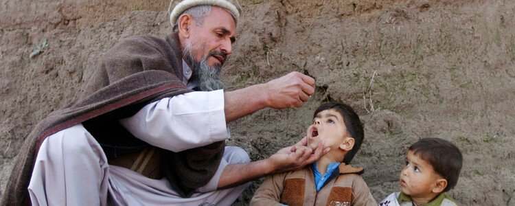 A child receives the polio vaccination during an anti-polio campaign on the outskirts of Jalalabad, Afghanistan