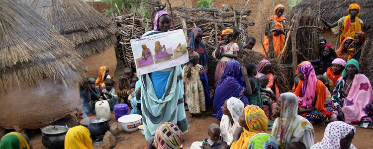 A health educator talks to women about mother and child healthcare in a village in Chad