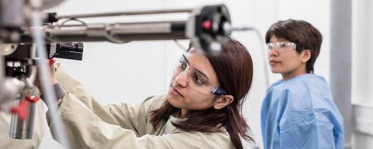 Woman scientist adjusting equipment in lab