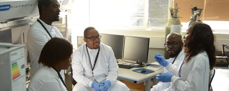 Kondwani Jambo (centre), Head of Viral Immunology at the Malawi-Liverpool-Wellcome (MLW) with this team in their laboratory in Blantyre, Malawi.