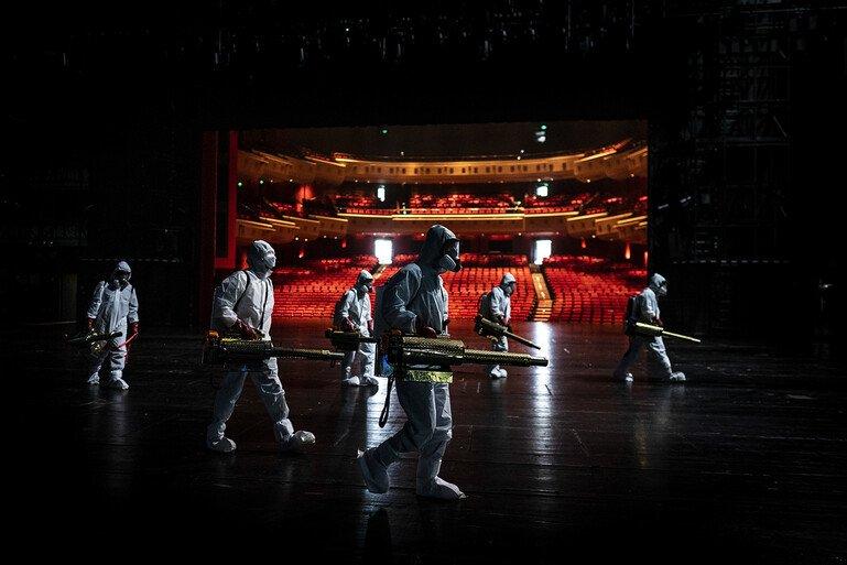 Volunteers dressed in hazmat suits disinfect the Qintai Grand Theatre in Wuhan, Hubei province.