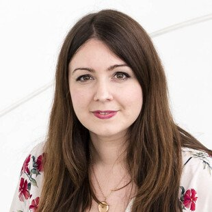 A photograph of the author, Lauren Couch.