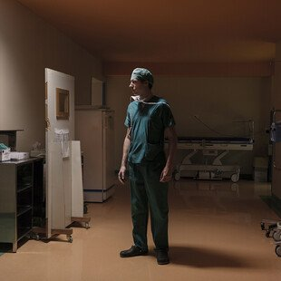 A surgeon looks in on a patient who he earlier gave a liver transplant