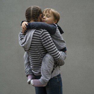 Portrait of a young Ukrainian mother, who is HIV positive, holding her son
