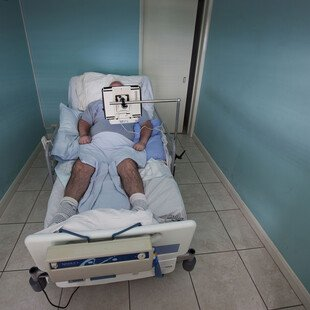 A man who had locked-in syndrome after a stroke in a specially adapted bed