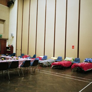 A row of beds in Torquay church hall.