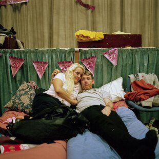 A man and woman lay on a bed in a local night shelter in Torquay.
