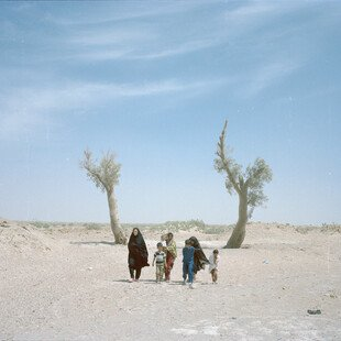 The Saravani family walk in the Sistan and Baluchestan region in Iran, now an infertile desert.
