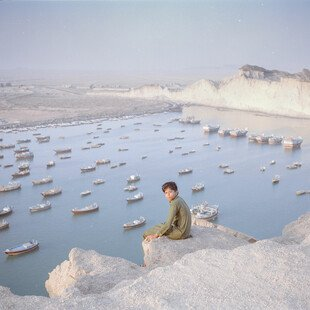 A young boy looks out towards Chabahar, a seaport in the southeastern area of Sistan and Baluchestan province