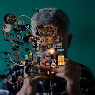 A portrait of the photographer's uncle looking at electrical equipment.
