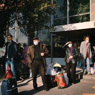 Displaced persons from Nagorno-Karabakh wait in Yerevan, Armenia, to be bussed to temporary housing.