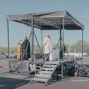 With indoor worship prohibited, an ecumenical Good Friday service is held at a drive-in cinema in Düsseldorf.