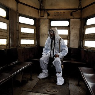 A tram conductor in Kolkata, India, wears protective clothing from head to toe during the Covid-19 pandemic.