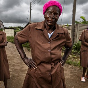 A trio of grandmothers, volunteers for Zimbabwe's Friendship Bench programme, stand at the ready.