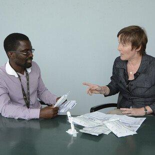 Liz Corbett and Augustine Choko demonstrate how to use the HIV self-testing kit