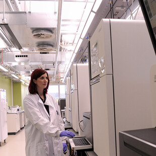 Scientist in a sequencing lab at Wellcome Sanger Institute.