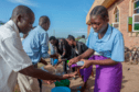 Parishoners in Malawi wash their hands as a preventive measure against the spread of COVID-19.