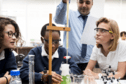 Three young people doing a science experiment