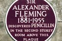 Maroon plaque on St Mary's Hospital London commemorating discovery in 1928 of penicillin by Alexander Fleming