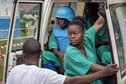 An Ebola response team in DRC, under the protection of UN troops wearing bulletproof vests and helmets.