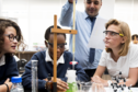 Three female students carry out a chemistry experiment