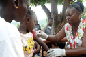 A girl gets a vaccination against measles from a health worker