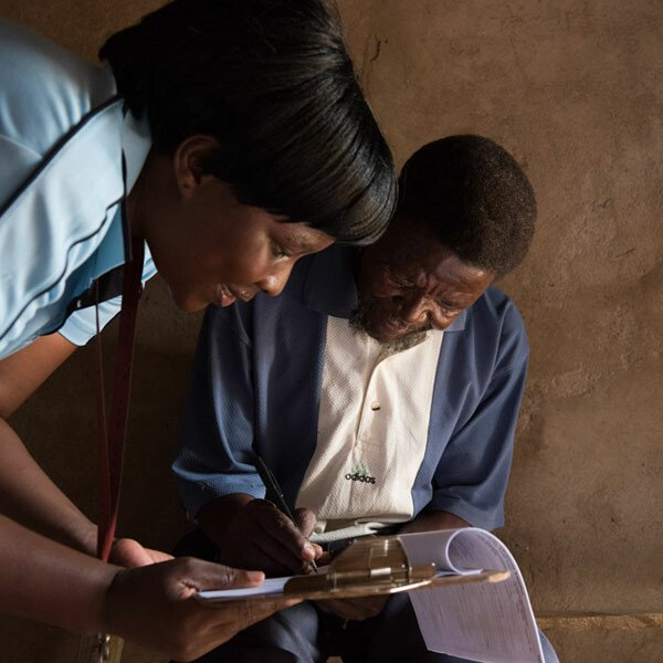 a fieldworker from the Africa Centre for Health and Population Studies, interviewing a local resident
