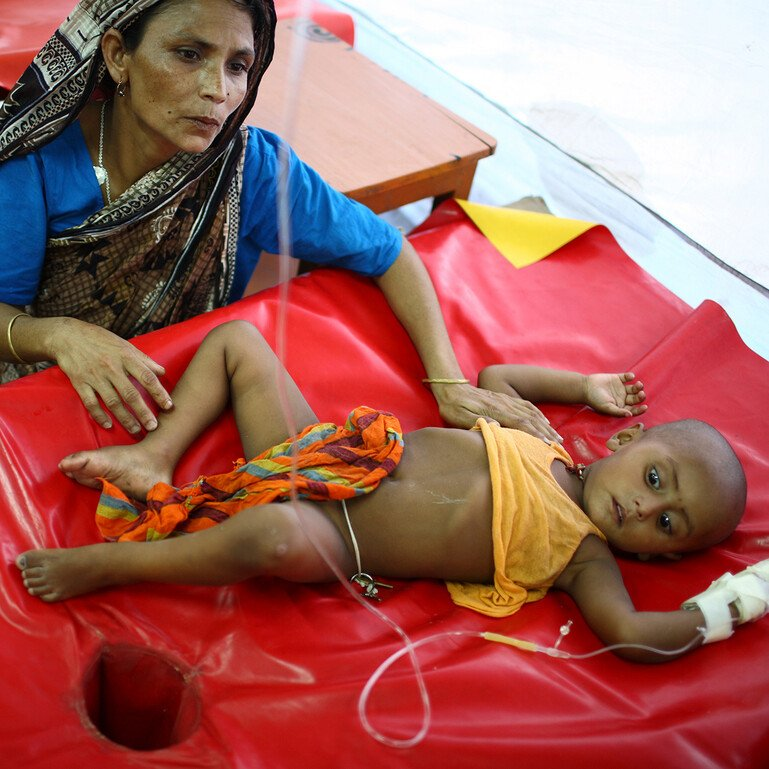 A child with diarrhoea being treated at the International Centre for Diarrhoea Disease Research, Bangladesh.