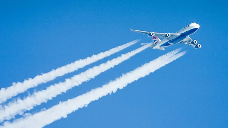 plane with contrails
