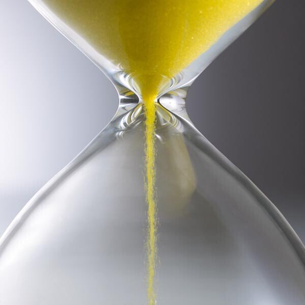 Image of sand falling through an hourglass