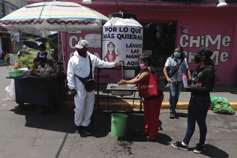 Residents in Mexico City wash their hands as a preventive measure against the spread of Covid-19.