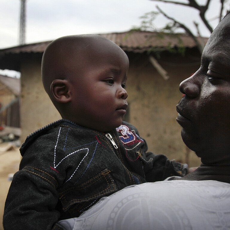 Father holding his toddler son in Bauchi, one of the regions in Nigeria affected by Lassa fever