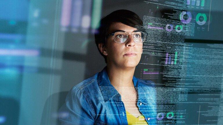 Woman looking at computer code