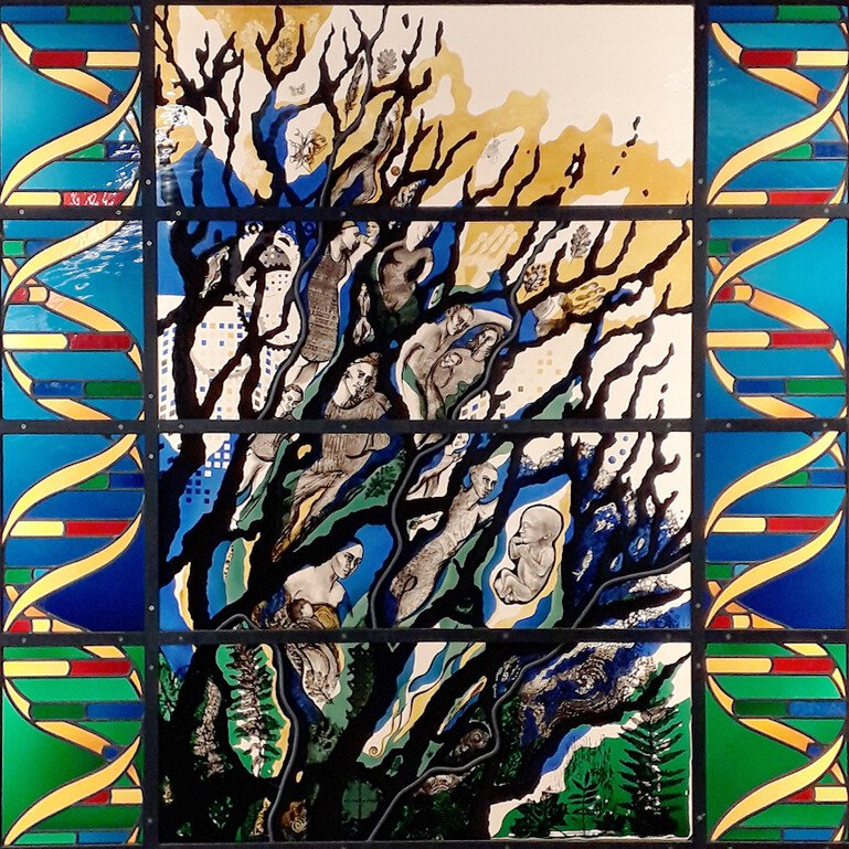 Detail from stained glass designed by Kathy Shaw Urlich, showing DNA and tree of life