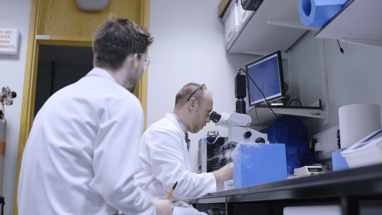Stephen and one of his PhD students in the lab