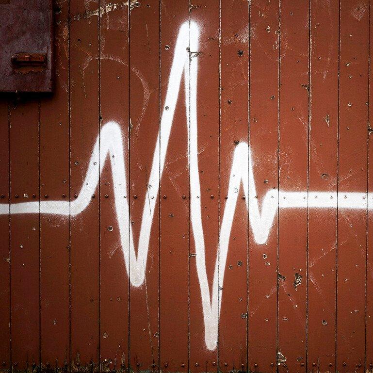 Graffiti of ECG reading on a wall