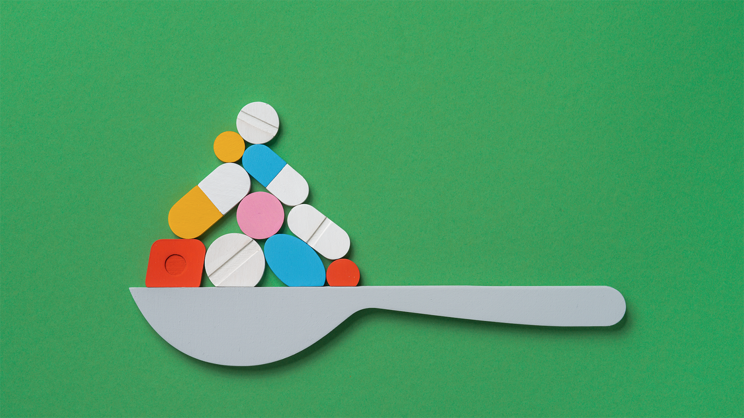 Illustration of a spoon with pills